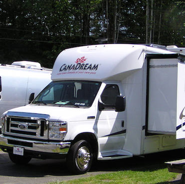 A CanDream rental motorhome with a slideout parked at a campground.