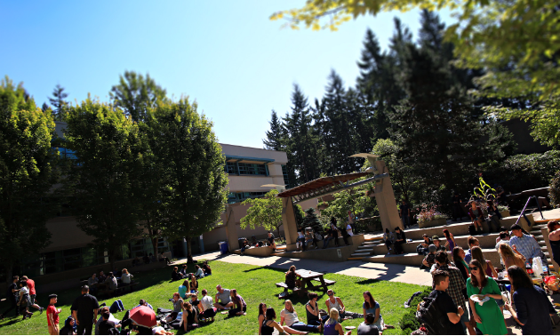 Students enjoy a balmy day on the Capilano University campus in North Vancouver.