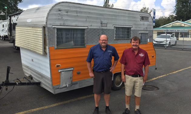 Chris and Dana Carstensen, the two sons of Kustom Koach founder Carl Carstensen, still work at the company dealership in Aldergrove, B.C. Here, they are pictured with Eric Hicks' restoration project.