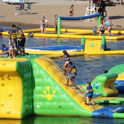 The Wibit, a floating yellow and green waterpark with trampolines, slides and other obstacles.