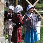 Three girls dressed in period costume at Historic O'Keefe Ranch