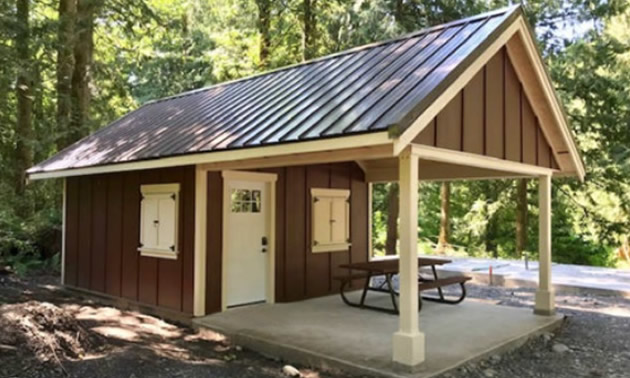 New cabin at Cultus Lake Campground, painted brown and yellow.