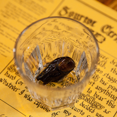A severed toe sits in a shot glass
