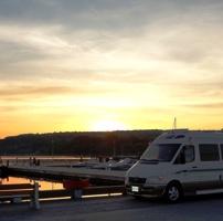 Photo of Tim Mallon's 2006 Roadtrek Adventurous at the dock of  Penetanguishene, Ontario at sunset.
