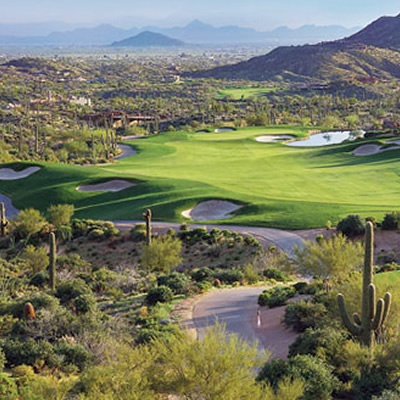 Overview of Desert Mountain Golf Club, showing the golf course and surrounding landscape.