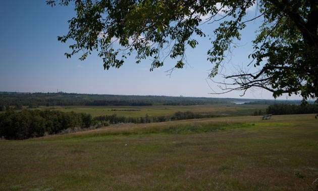 View from Eieling Kramer Municipal Campground in Battleford, Saskatchewan showing expanse of grassland and rolling hills.