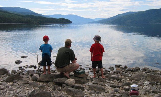 kids learning to fish on a lake