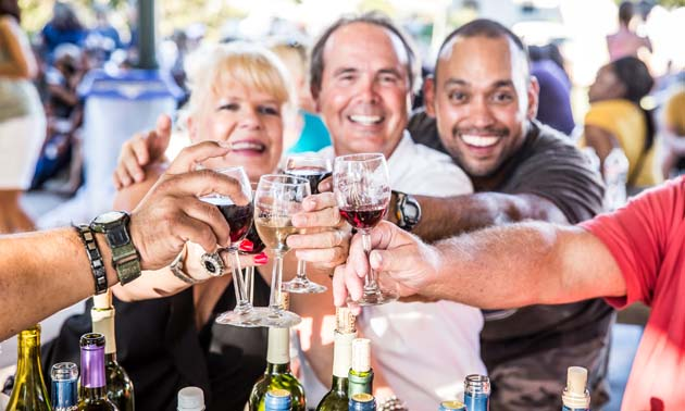 Participants cheers at the Fredericksburg Food and Wine Fest.