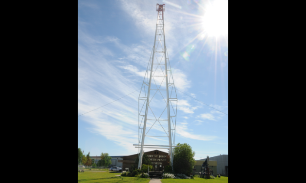 Fort St. John's North Peace Museum pays homage to its oil industry by displaying an oil derrick in front of the building.