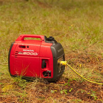 Picture of red and black Honda generator.