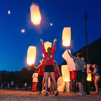 Families release wish lanterns into the night sky