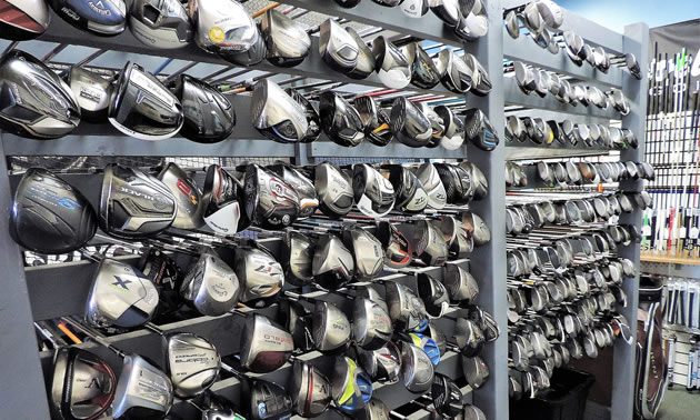 A large display of drivers and fairway clubs