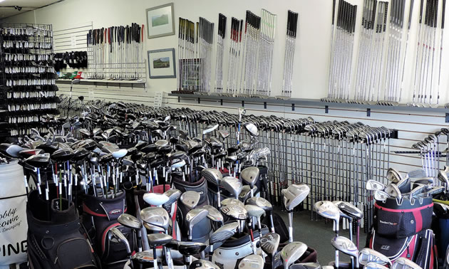 An inside view of the Arizona Golf Exchange with rows and rows of golf clubs and bags