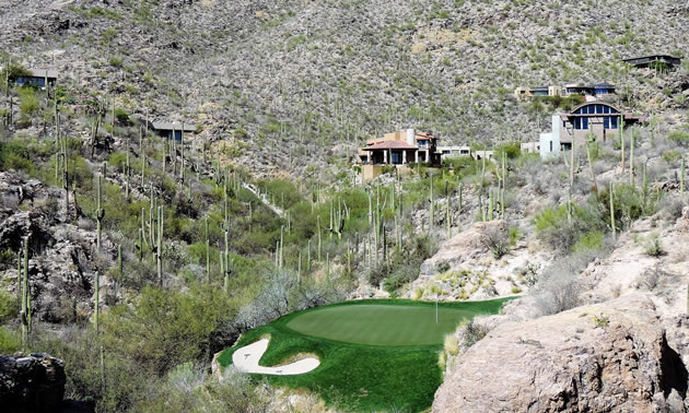 The third hole of the Mountain Course at Ventana Canyon in Tucson, Arizona, is surrounded by saguaro cacti and a desert landscape.