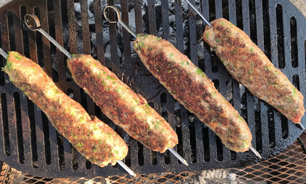 Meat skewers on grill.