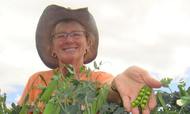 Elna Edgar with her freshly picked peas.