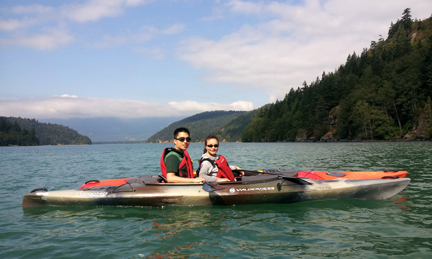 A couple of Kayakers on Harrison River in British Columbia.