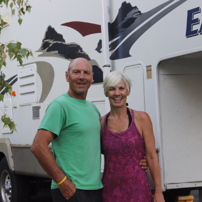 John and Shelley Smith stand proudly beside their 2006 28-foot Eagle fifth wheel.