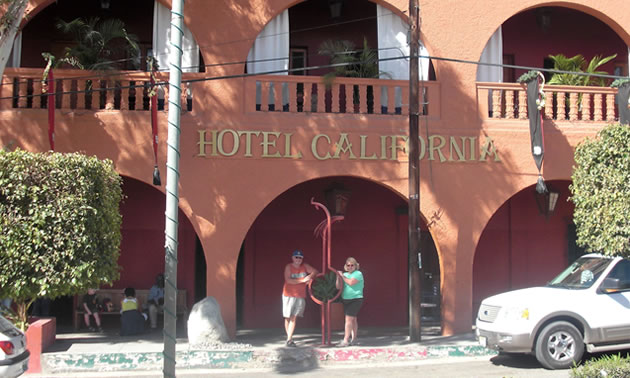 Dan and Lisa Goy standing in front of the Hotel California.