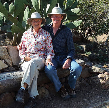 Kevin and Ruth Read sitting in front of a cactus in Mexico