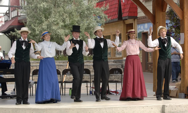 A group in period costume performing in the Platzl in Kimberley, B.C.