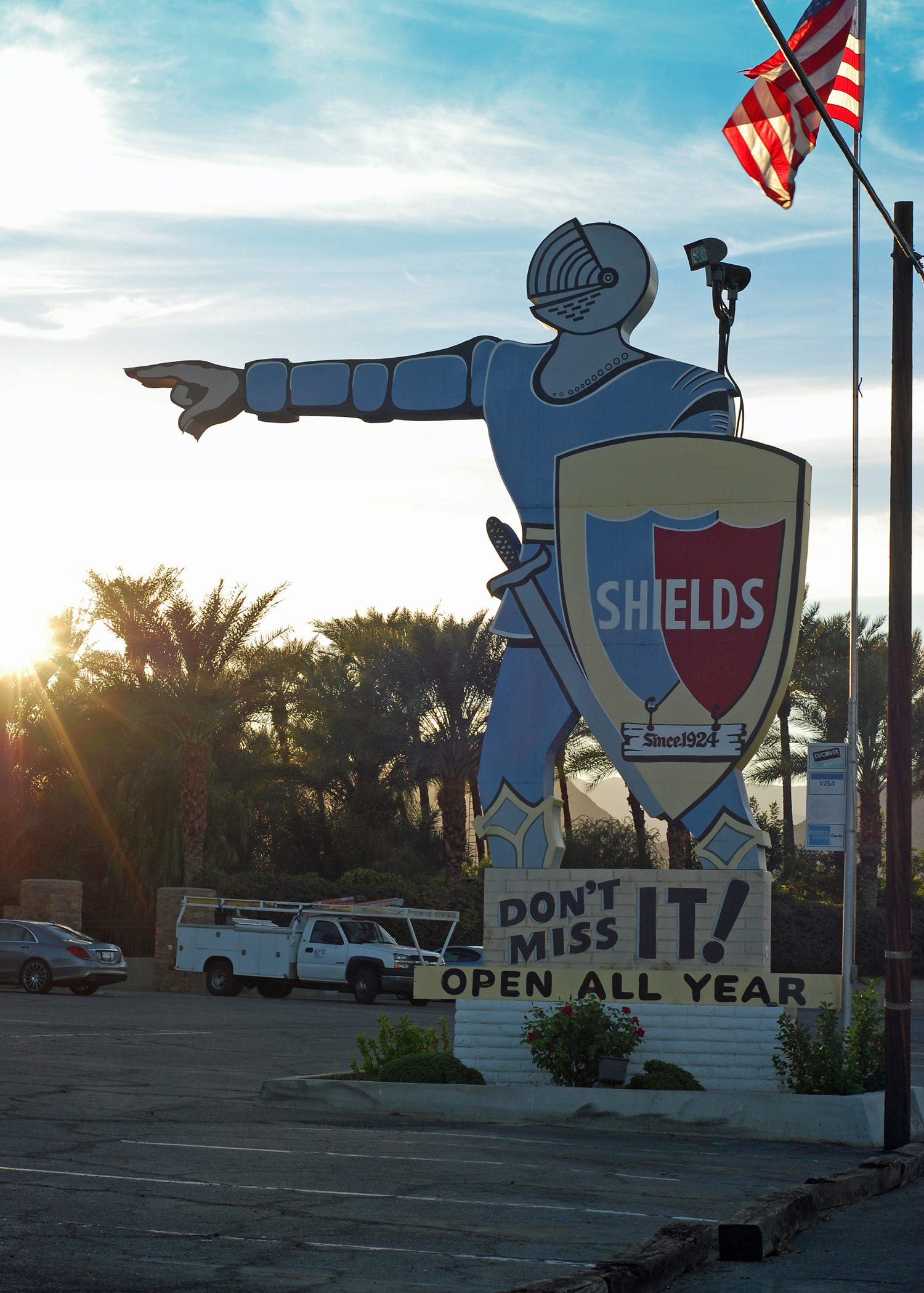 A sign depicting a knight points to Shields Date Garden.
