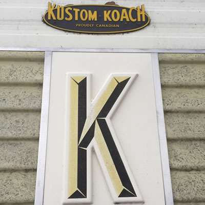 Close-up of the Kustom Koach logo.