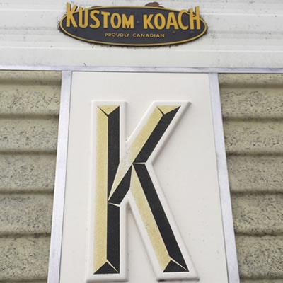 Close-up of the Kustom Koach logo.