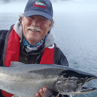 Larry Stefanyk of Campbell River, B.C., with a large, silver salmon