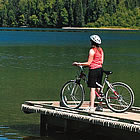 person on a dock riding their bike