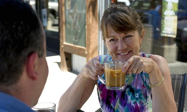A woman drinking coffee outside a Merritt, B.C. cafe.