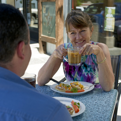 A woman drinking coffee outside a Merritt, B.C. cafe.
