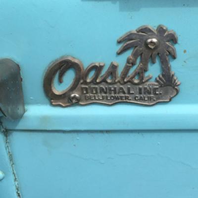 The Oasis Travel Trailer company logo.