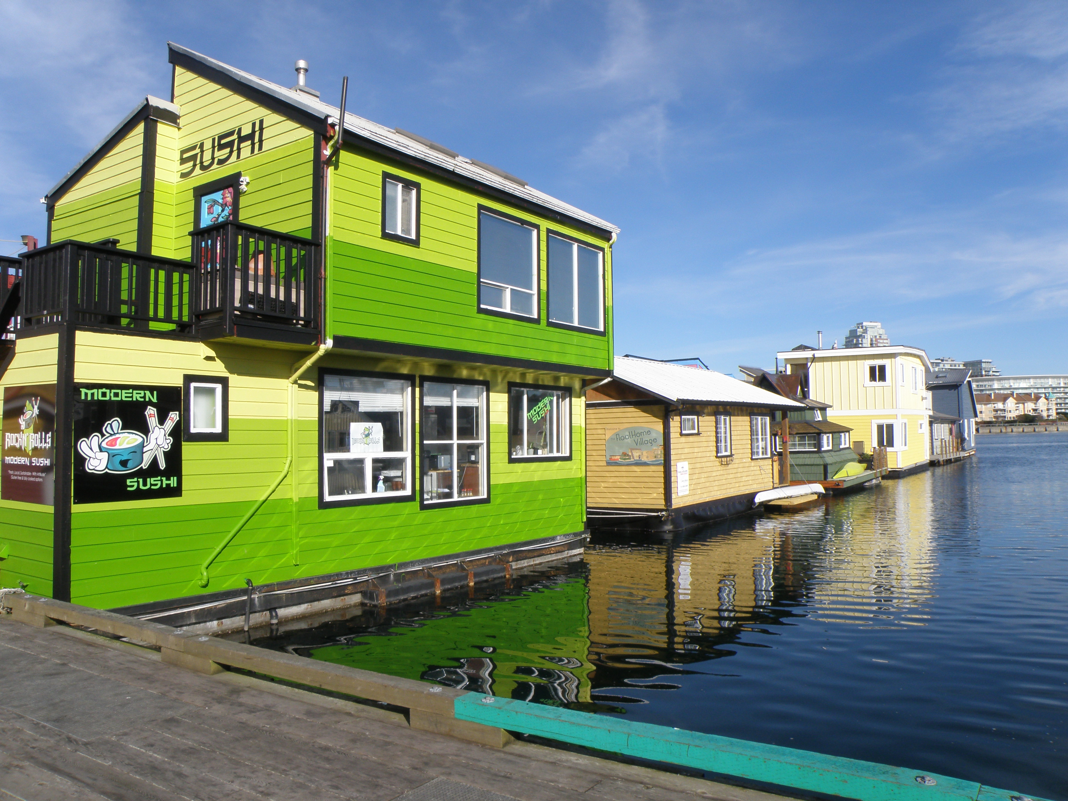 A lime green floating house boat.