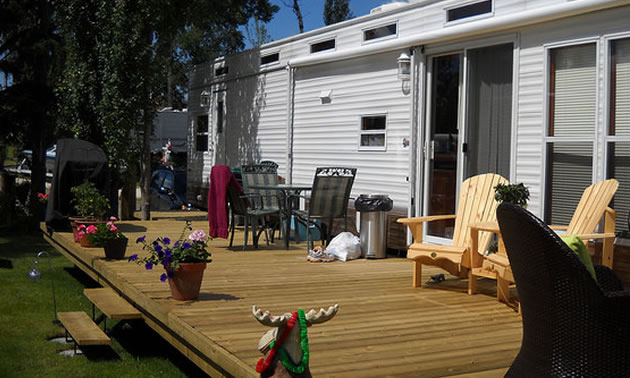 The wooden deck on this park model increases outdoor living space.