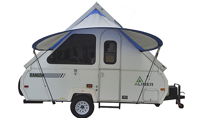 A framed towable trailer with the PahaQue Visor open and installed providing shelter from the rain and protection from the sun
