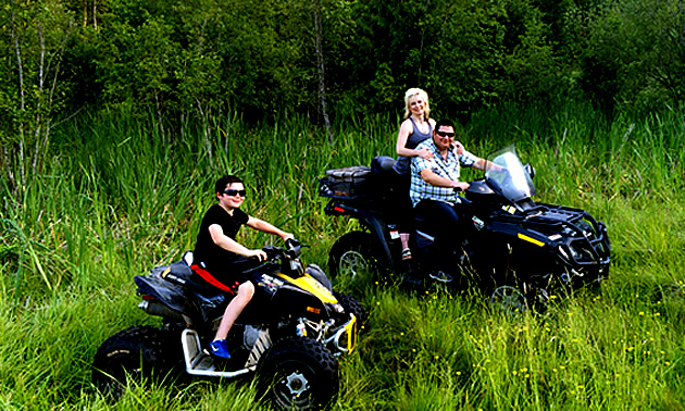 Eric Buckley, Nicole Lind and Will Buckley quadding in a field in the Pend d'Oreille region in B.C.