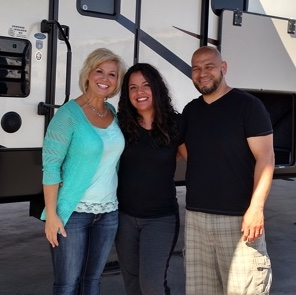 Johnnie Walker RV Salesperson Shawna Fitch  with customers Cesareo and Janette Razo.