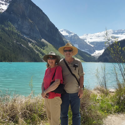 Ralph and Donna standing in front of a beautiful mountain vista