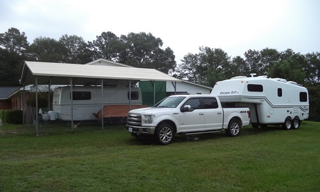 Reace's road rig is parked adjacent to the customer's carport and 21-foot Escape Trailer.