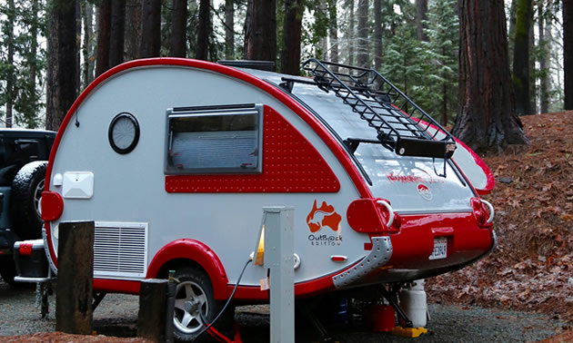 Red and white retro RV rental at The Inn Campground in Nevada City.