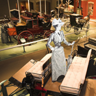 interior of museum with horse-drawn carriages on display