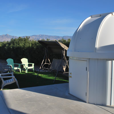 Small observatory surrounded with chairs and loungers.