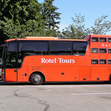 A red Das Rollende Hotel parked as an RV