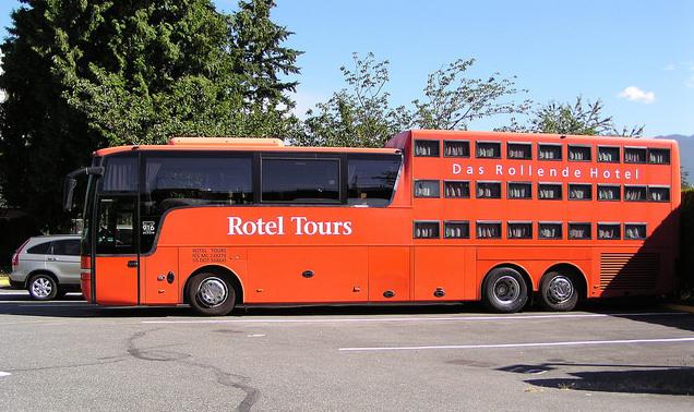 A red Das Rollende Hotel parked as an RV