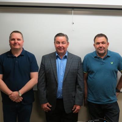 RVDA of Alberta Executive Director Dan Merkowsky (centre) and SAIT RV techician instructors.