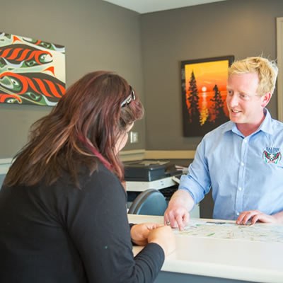 Manager and customer talking at Salish Seaside RV Haven.