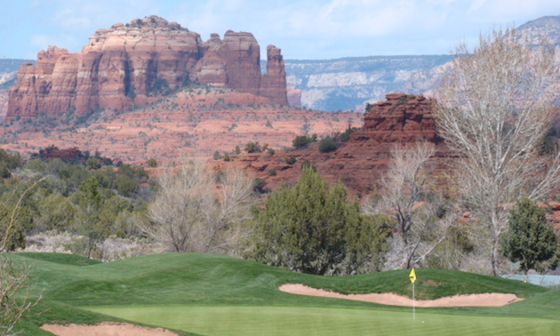 Desert rock formation and golf green