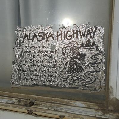A sticker in the back window of an RV trailer.