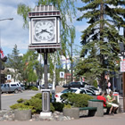 Smithers alpine Main Street includes red paved sidewalks, a large alpine clock and greenery.